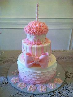 Giant cupcake tiered pink bow amd ruffle cake