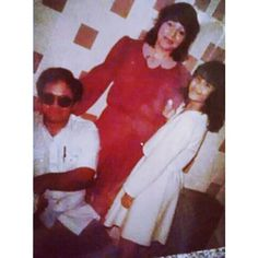 Selena Quintanilla with her parents