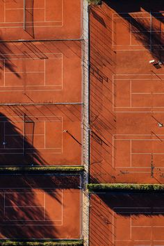 An aerial view of clay tennis courts