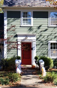Orange front door green siding white trim for the home for White house green trim