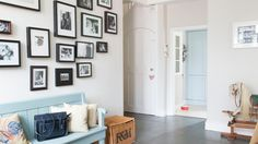 Hallway with Painted Bench and Family Photo Wall