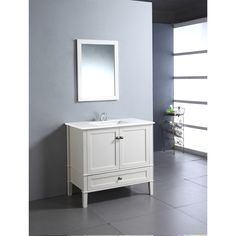 The 36-inch Windham Bathroom Vanity is defined by its soft white lacquer finish, brushed nickel rounded square knobs and casual contemporary look. This beautiful assembled vanity provides a large storage area behind two doors with large bottom drawer.