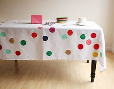 This is basically a genius idea from Jenny Batt blogging at Oh Happy Day. DIY Confetti Tablecloth