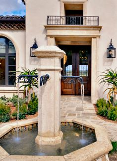 Tuscan style entry courtyard with fountain...