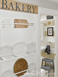 Showcase pretty platters in a hallway. Here, plate racks line the walkway between a kitchen and bathroom and offer storage that's also stylish. Dishes with unique details (like crimped edges or texture) are cute and stay out of the way.