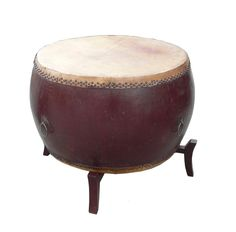 This is a traditional Chinese drum in rustic brown lacquer color. It is an old used piece, so the top is not in perfect condition. There is a wooden four legs stand to lift up the drum. It can be a co