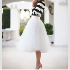 Black & Pink Tulle skirt. White is sold!! I Have these in pink and white. All NWOT. STILL IN PLASTIC!!  Pictures speak for themselves!! Absolutely stunning skirts. Can be cute for a summer day or a night on the town!!This picture doesn't belong to me!! Skirts