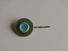 Green & blue vintage buttons layered on a silver bobby pin, by two dot designs