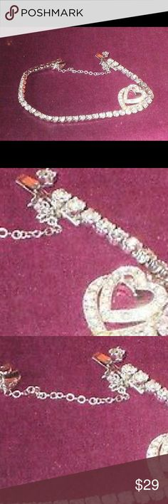 Weiss signed silver tone rhinestone heart bracelet vintage rhinestone hanging hearts bracelet. It is made from silver-tone metal and is set with round clear rhinestones........please click on photos to see enlarged detail. The bracelet measures 6 and 3/4'' by 1'' including the hearts and has a push-in clasp together with a safety chain. All rhinestones are present and shiny. The metalwork shows no signs of corrosion. The bracelet is stamped 'WEISS' within an oval cartouche.  First Class…