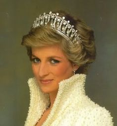 The Cambridge Lover's Knot Tiara gets its Cambridge name because it was made for Queen Mary to look like a tiara once owned by her grandmother, the Duchess of Cambridge.  It's a gorgeous tiara, with its drop pearls and heart motifs.  It is the Tiara selected by the Queen for Diana, Princess of Wales.  Nobody EVER wore a Tiara like Diana!