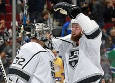 VANCOUVER, BC - DECEMBER 30: Jake Muzzin #6 of the Los Angeles Kings congratulates teammate Jonathan Quick #32 after winning their NHL game at Rogers Arena December 30, 2017 in Vancouver, British Columbia, Canada. The Los Angeles Kings won 4-3. (Photo by Jeff Vinnick/NHLI via Getty Images)
