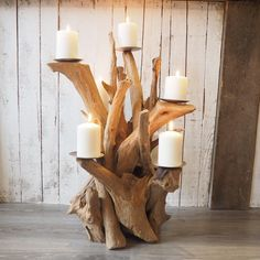 This stunning driftwood effect candelabra. Rustic teak root creates this unique candle holder allowing such dramatic candlelight to be created.