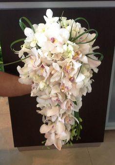 Bridal Bouquet. Cascade Bouquet. White Orchids. White Cymbidium Orchids. Green Leaf Loops. Weddings. Birthdays, Anniversaries. Terra Flowers Miami. For more styles, please visit www.TerraFlowersMiami or www.facebook.com/TerraFlowersMiami