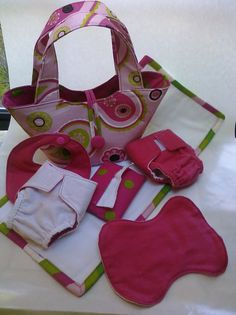 Doll diaper bag set for purchase from etsy...I would LOVE to figure out how to make this myself!
