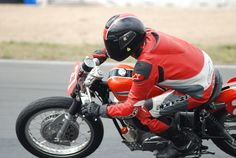Noel Howe races this stock-looking 1962 XLCH Harley-Davidson Sportster against more nimble Nortons and Tritons.