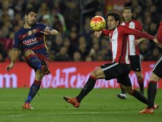 Barcelona's Uruguayan forward Luis Suarez (L) kicks the ball next to Athletic Bilbao's defender Xabier Etxeita during the Spanish league football match FC Barcelona vs Athletic Club Bilbao at the Camp Nou stadium in Barcelona on January 17, 2016.