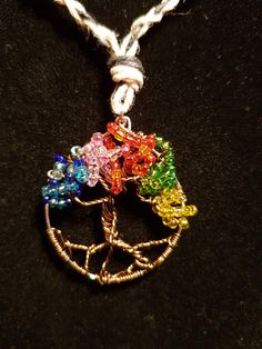 Tree of Life pendant is hand crafted and featured on a hemp rope necklace.