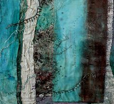 At the Edge of Shore, Sea, Sky. textile art by Susan McEwan. Using open and closer-woven fabrics and painted and plastered them to suggest the texture and erosion found on the shoreline.  Folds, tucks and stitching were added, echoing the patterns in the sand left by the sea, and strata in rocks.