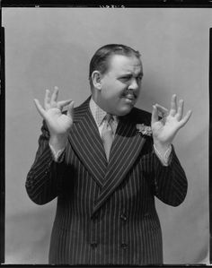 Charles Laughton as Hercule Poirot.