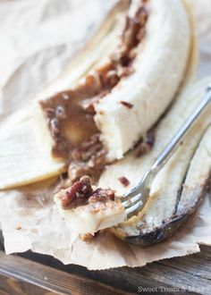 """Bananas stuffed with almond butter and cinnamon toasted pecans, baked in the oven for a healthy treat! Yesterday I found myself """"cracking out on nut butter and fruit"""" and this was the result.  Technically, these oven baked Cinnamon-Pecan Almond Butter Banana Boats aren't Whole30 compliant. The ingredients are, but the concept isn't. While on..."""