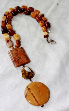 Created from Mookite and Jasper stones of shades of orange, yellow and browns and sterling silver/ 16""