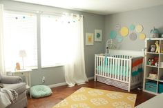 Sweet gender neutral nursery.....love the mix of patterns and colors!!