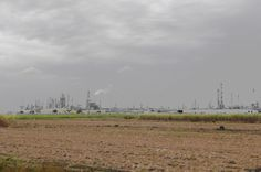 Donaldsonville, AL plowed up Sugar Cane Field with an Oil Refinery in the backdrop!