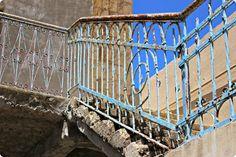 handmade by amalia.  Beautiful rusty railing.