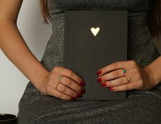 Journal ,writing journal, journal diary , black journal with Gold heart  Stunning black journal with Gold foil heart stamped on the front.  What a gorgeous gift for the one who loves to write, having 120 lined pages to write down your plans,dreams and thoughts.  With the Gold heart, it would be a super romantic gift for your loved one, or a great christmas gift.  Size of notebook is A5.   It can be a great set with the Black mug with Gold heart:  https://www.etsy.com/il-en&#x2F...