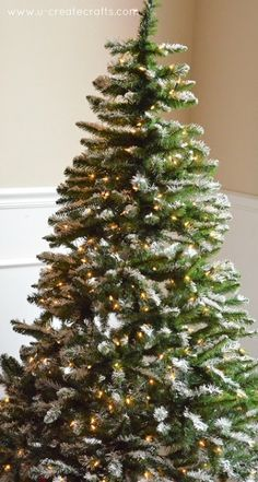 How to flock an artificial, pre-lit tree. I am so doing this! #howtoflockatree #howtoflock #flockedtree #christmastree #aflockingwewillgo #flock #flocking