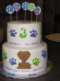 puppy paws cake ( cricut ) - This was for a Puppy themed birthday party . Iced in buttercreme with fondant decorations - all decorations were cut using my cricut cake .