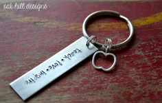 ........teacher thank you.......    this listing features a 2 1/2 inch long ALUMINUM keychain stamped with teach.love.inspire and topped off with