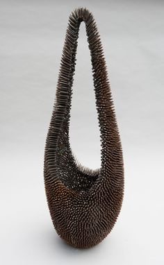 Maya  Whitner - Maya Whitner at Seager Gray Gallery showing Fibroin Nest a sculpture of welded steel nails.
