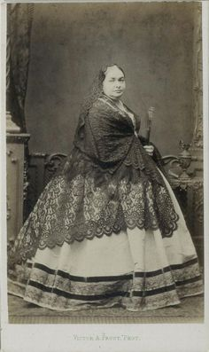 CDV: Woman in a hooped dress & lace shawl by Prout, Baker St, London. Dated 1863
