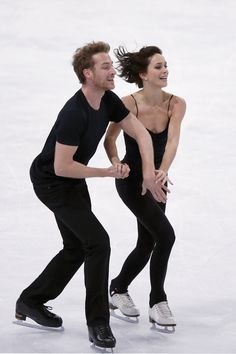 Nathalie Pechalat and Fabian Bourzat of France perform their Ice Dance routine during a practice session ahead of the ISU Figure Skating Eric Bompard Trophy at the Bercy arena in Paris, Thursday, Nov. 14, 2013. (AP Photo/Francois Mori)