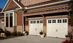 @Clopay Doors | Residential Garage Doors and Entry Doors | Commercial Doors Gallery Collection Steel Short Grooved Panel Carriage House Style Garage Doors in White with Short Square Glass