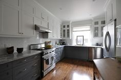 Love the white uppers, and gray lowers.  Everything looks great, not overly white or designed.    Meredith Heron design.
