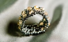 Beaded ring with amber yellow faceted czech beads and hematite seed beads