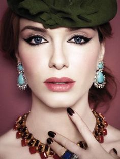 Christina Hendricks...the perfect winged liner, porcelain skin and lips.
