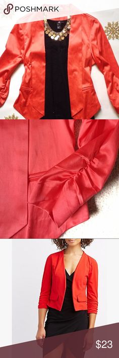 Stain Cropped Blazer in Red-Coral Gorgeous cropped satin blazer!  Pairs well with many outfits, especially for holidays!  The last photo is of a similar blazer, for alternate outfit inspiration!  The sleeves have cinched detail at the ends (see second photo).  Never worn, pristine condition. Charlotte Russe Jackets & Coats Blazers