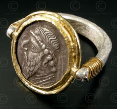 Parthian coin ring Reversible gold and Sterling silver ring set with a Parthian silver drachm of king Mithradates II (c. 123 - 88 B. Found among an ancient hoard in Herat, Afghanistan.