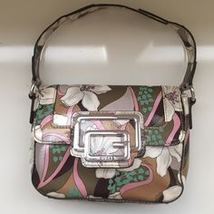 Guess shoulder purse Floral shoulder purse by Guess. Slight wear on hardware Guess Bags