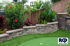 Small retaining wall perfect for a garden of any size. Small Retaining Wall, Retaining Wall Blocks, Artificial Turf Grass, Landscape Walls, Backyard, Patio, Brick Wall, Cool Photos, Outdoor Decor