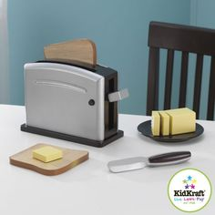 Children often want to help their parents in the kitchen. With our new Kidkraft Espresso Toaster Set your young helpers will be able to take care of the toast all on their own! The 9 piece Kidkraft toaster set includes toaster, toast, butter and more!