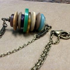 Vintage button necklace                                                                                                                                                                                 Mais
