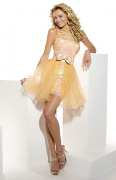 This short and cute Hannah S 27632 dress is perfect for a classic southern belle! It has a ton of cutesy detail that is sure to make a timeless statement! It's available in Coral or Silver! Wear this to a sweet 16, Sorority event, or even to Prom! The layered sequin detailing along with satin and tulle creates afab texture and shape! Wear this with matching accessories and shoes for a complete look!