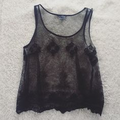 AE Sheer Lace Overlay Black sheer overlay tank. American Eagle Outfitters; Wear with a black cami, jeans and heels! American Eagle Outfitters Tops