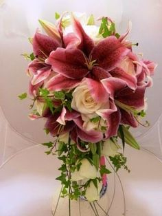 Pink lily and ivory rose shower bouquet Sandra's Flower Studio