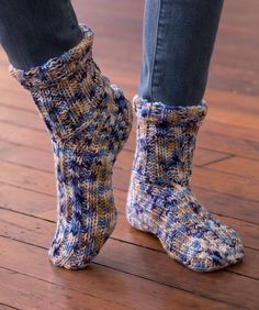 Easy knit socks function great on their own as slippers, or wear them with boots to stay extra-toasty. Multi-coloured yarn adds interest without extra work.