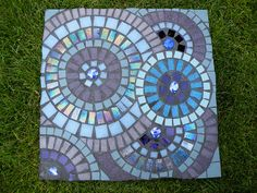 Blue circles on square mosaic stepping stone